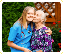 patient kissing the cheeks of a female caregiver